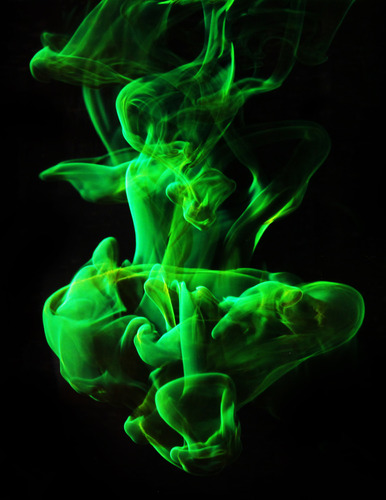 fuckyeahfluiddynamics :     A drop of fluorescent dye falling into quiescent water forms fantastical structures that are a mixture of  vorticity ,  turbulence , and  molecular diffusion . The horseshoe-like shape near the front of the drop is a typical shape for two fluids strained by moving past one another. The main section of the drop billows outward like a parachute, but the turbulence of its  wake  stretches the dye into fine threads that quickly disperse in the water. (Photo credit: D. Quinn et al.)