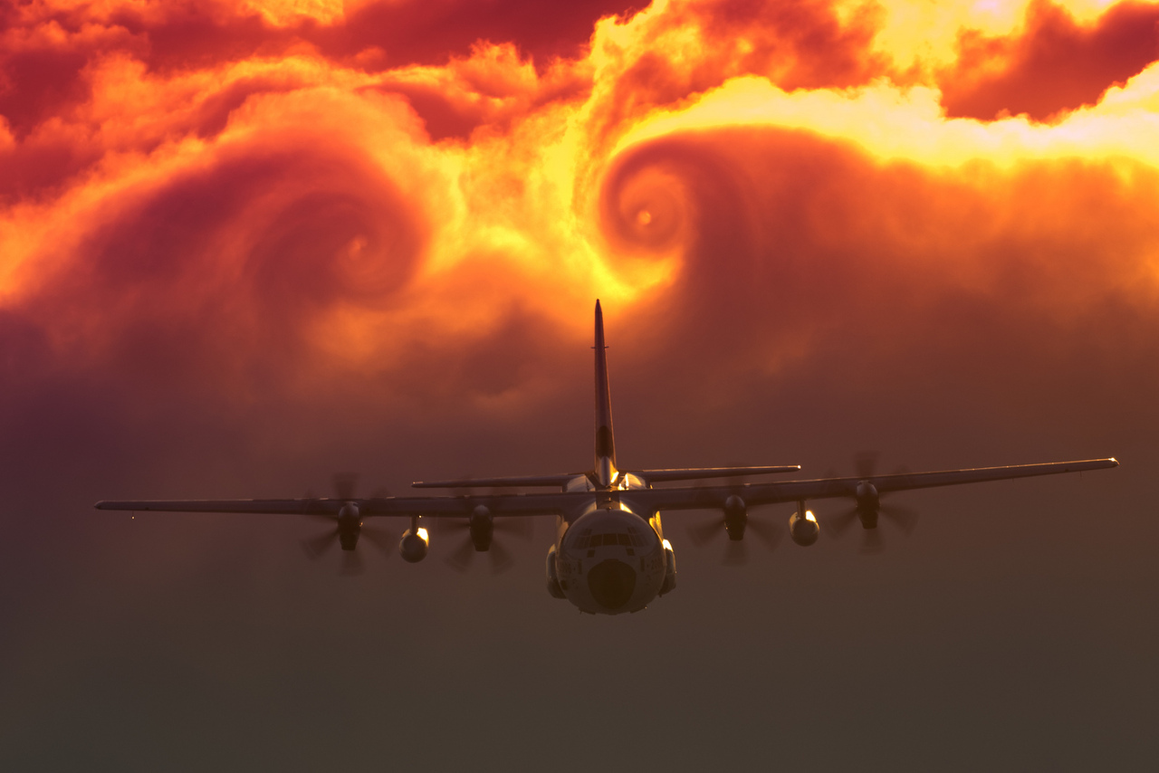 fuckyeahfluiddynamics: Wingtip vortices roll up in the wake of this U.S. Coast Guard C-130J. At the edge of a wing high-pressure, low velocity air is able to creep around the edge of the wingtip toward the low-pressure, high-velocity air atop the wing. This creates a swirling vortex that trails behind each wing, made visible here by the clouds entrained in the plane's wake.  Over time, these counter-rotating vortices will sink downward and break up due to viscosity and instabilities induced by their proximity. (via Aviationist)