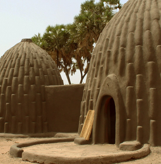 "miss-mary-quite-contrary :      archizoo :  Mud huts  ""the musgum, an ethnic group in far north province in cameroon, created   their homes from compressed sun-dried mud. the tall conical dwellings,  in the shape of a shell  (artillery), featured geometric raised   patterns"""