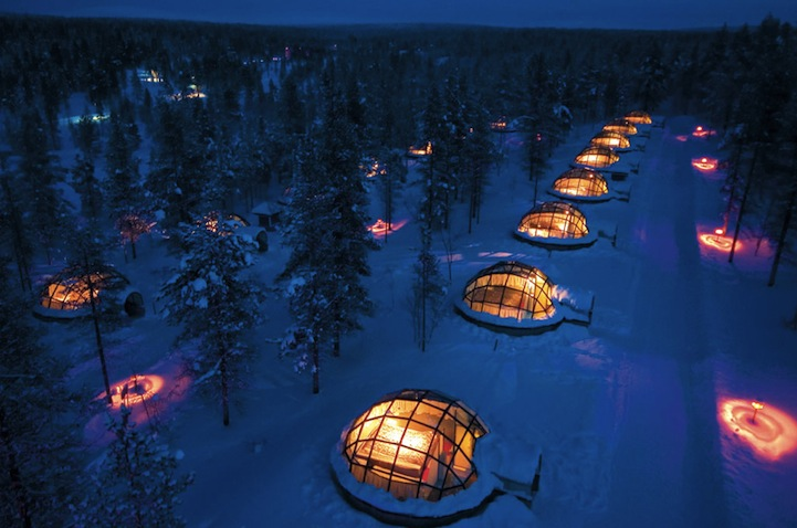 "parsonsees: ""The Igloo Village in Kakslauttanen, Finland is like the Rolls-Royce of ice hotels. Each igloo is equipped with glass that allows you to gaze at the northern lights and millions of stars, all while relaxing comfortably in your warm room. The glass igloo is a a marvel of modern technology, which is based on a groundbreaking idea and years of research and development. Built from special thermal glass, the view stays clear even when the temperature outside drops to under -30°C. Every igloo is equipped with a toilet and luxury beds and, every evening, a hot sauna and a refreshing ice hole await you."" (via Glass Igloos with Magnificent Northern Lights Views - My Modern Metropolis)"