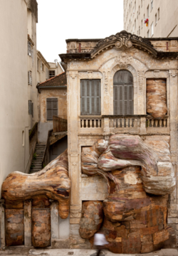 claresophiet :     Henrique Oliveira is a Brazilian artist known for working with salvaged wood which he peels and used to create these incredible installations. The texture of the wood is reminiscent of the strokes of a paint brush or the folds of human fat, giving some eerie, living feeling to his installations, as if they should start breathing. Like a mass of tree roots or a spinal cords, his pieces seem to support the gallery walls, their parasitic growth holding them up, like a tumour, gluing together but also invading the space. Their luscious organic colours bring to mind skin, flesh, rolls of the stomach. Each piece is site specific, the artist responds directly to the architecture of each gallery they are installed in.   Click through on the image for a link to his website.