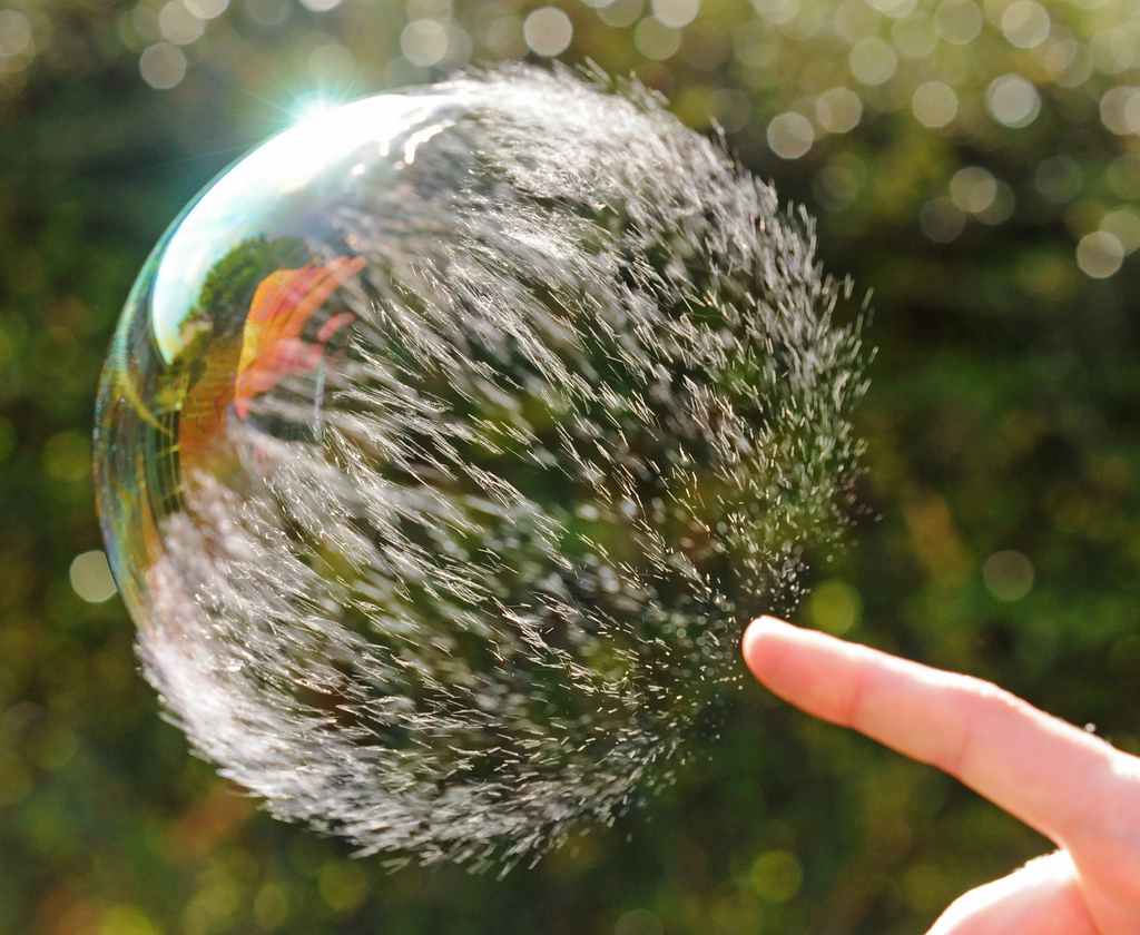 fuckyeahfluiddynamics :     A  soap bubble  bursts when its  surface tension  is broken, and, although from our perspective, the bubble bursts instantly, the process is actually directional. The bubble disintegrates from the point of contact outward. See it in high-speed video  here  or see more photos  here . (Photo credit:  Richard Heeks )  #