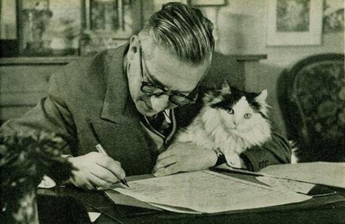 Jean-Paul Sartre and his existentialist kitty.