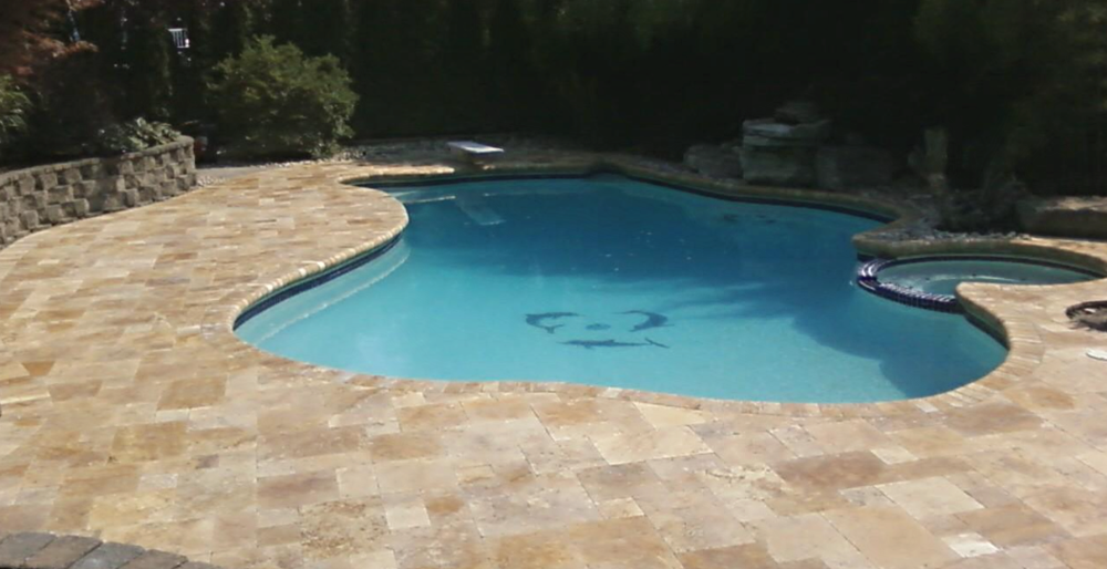 Travertine pool patio installed by Green Nature Landscape Design in Morris County, NJ.