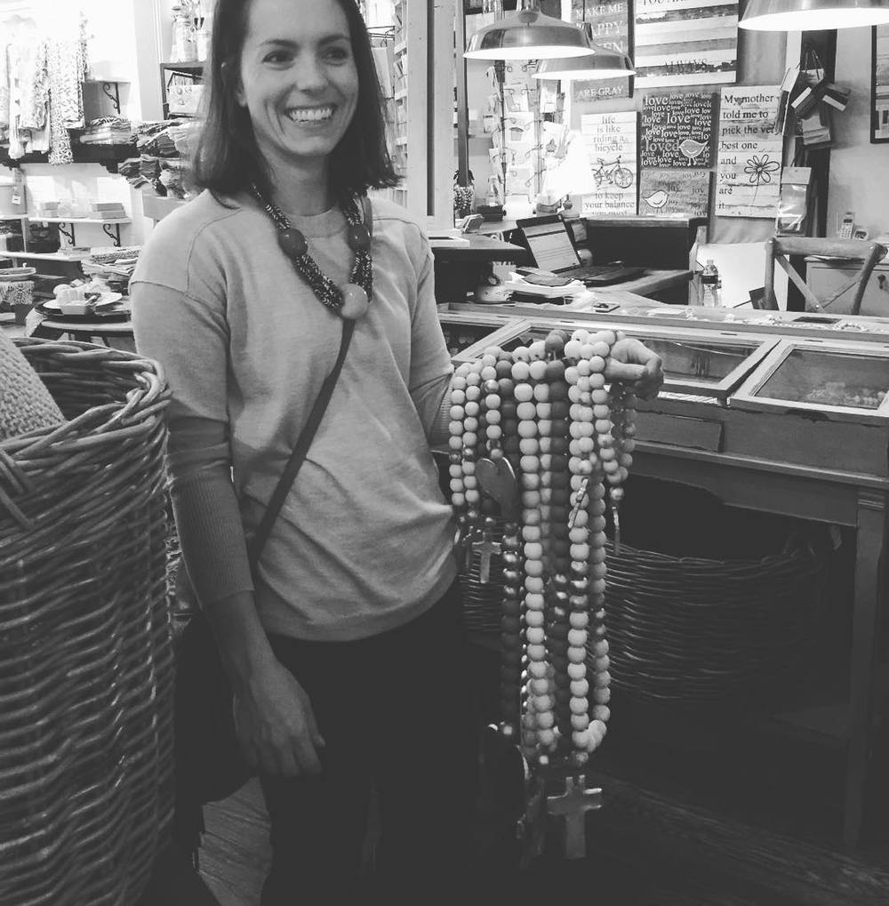 Our favorite picture of Mackenzie holding many strands of Blessing Beads