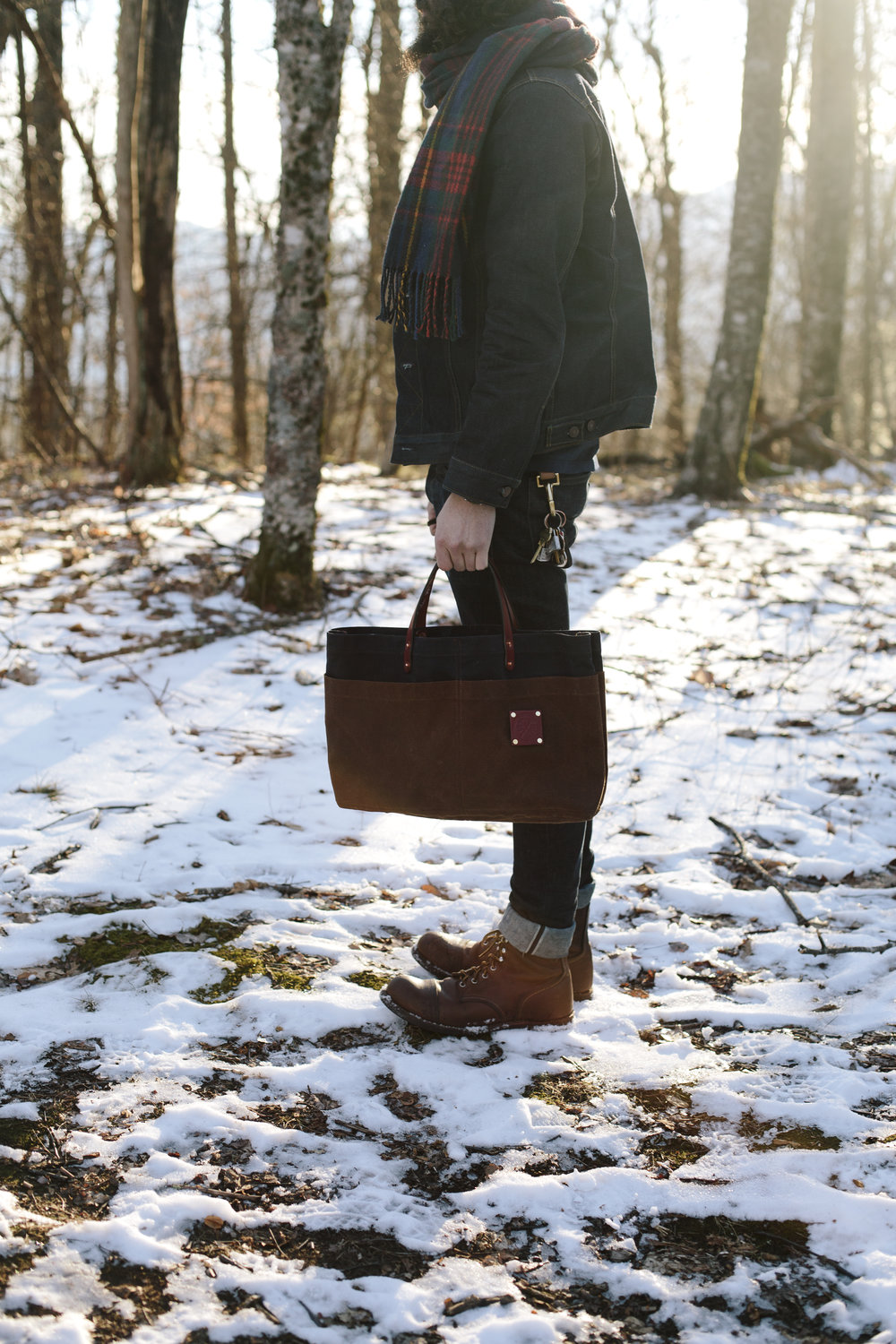 Man Carry in the snow Sturdy Brothers Waxed Canvas.jpg