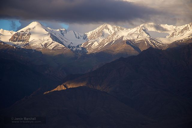 Leh (Hindi: लेह), Tibetan: གླེ ), Ladakh in the Indian Himalaya (Jammu & Kashmir state) is nestled in the palm of spectacular mountains. Here a dawn exposure taken on a recent trip. Leh district, with an area of 45,110 square km, is the second largest district in India. Leh is at an altitude of 3,524 metres (11,562 ft) and was heavily damaged in 2010 by the sudden floods caused by a cloud burst.  Follow @tribaleye for updates, outtakes, unpublished and archive material.  @stevedaveyphoto  @jhachetan241  @simonnorfolkstudio  #globalnomads #wanderlust #traveltheworld #travelgram #travelphoto #ladakh #india #himalayas #yourshotphotographer  #theindianroute #igs_asia #nikonphotographers  #burnmagazine #instamagazine_ #bbctravel #myfeatureshoot #profile_vision #lensculture #himalayas #leh #ldawn #lmountains #himalayankingdom