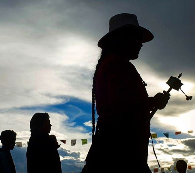 Silhouetted shapes of Tibetan pilgrims, Lhasa, Tibet