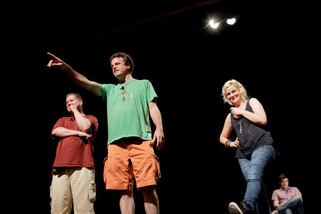 "Ian Roberts, Matt Besser, and Amy Poehler take a suggestion in an Upright Citizens Brigade ""Asssscat 3000"" show"