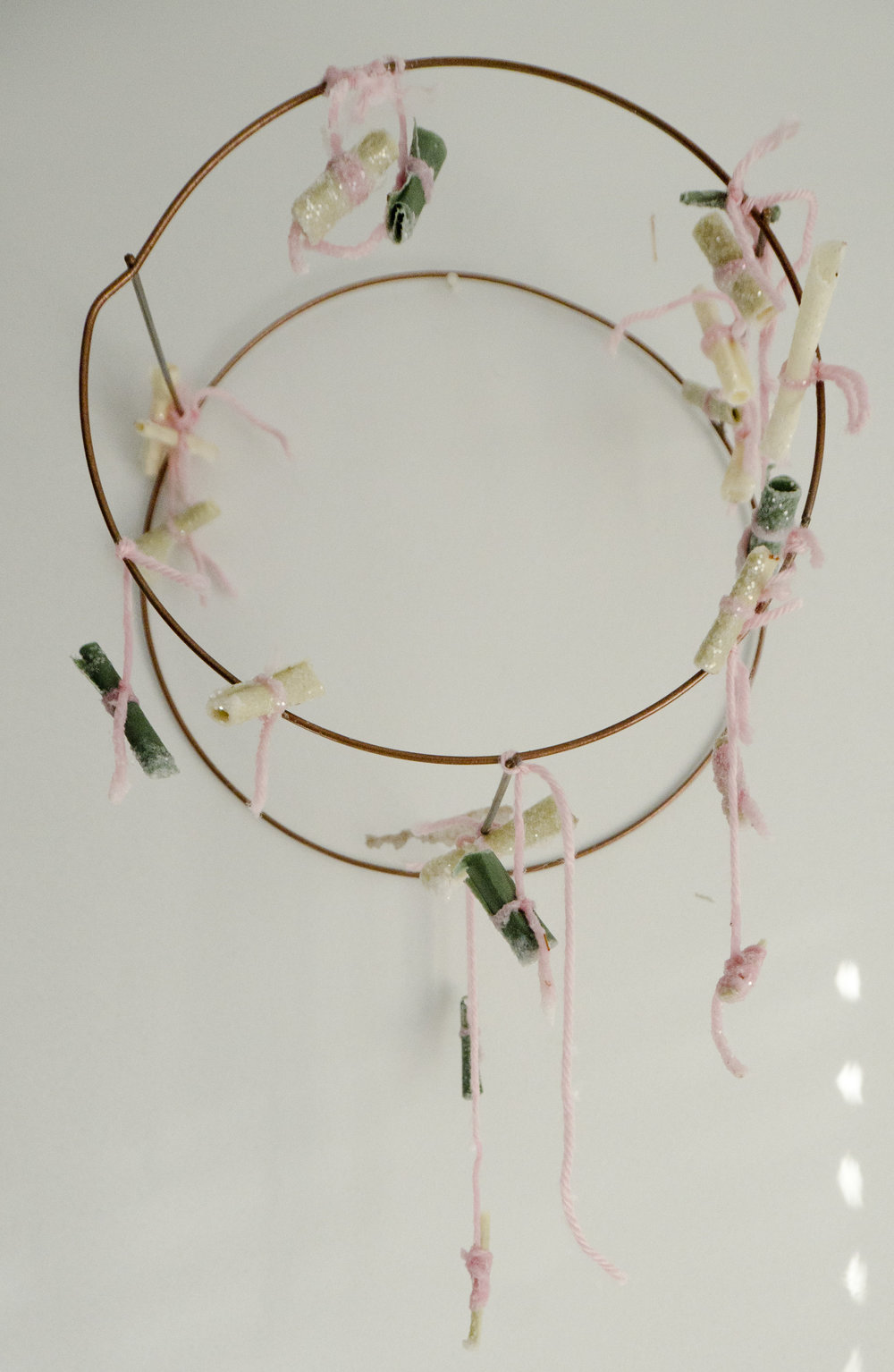 For Protection and Affection   2018  Wax, herbs, glitter, yarn, pencil, and paper, on wire armature  the artifact from the performance piece, containing the charms made during the event
