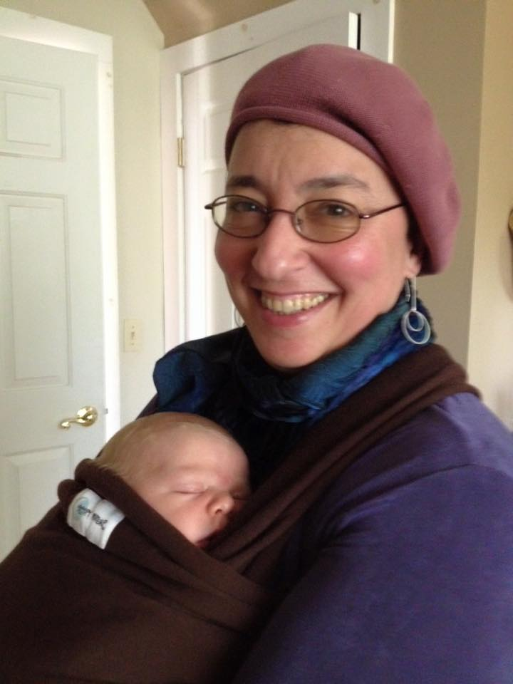 Amy wears a patient's baby at the clinic!