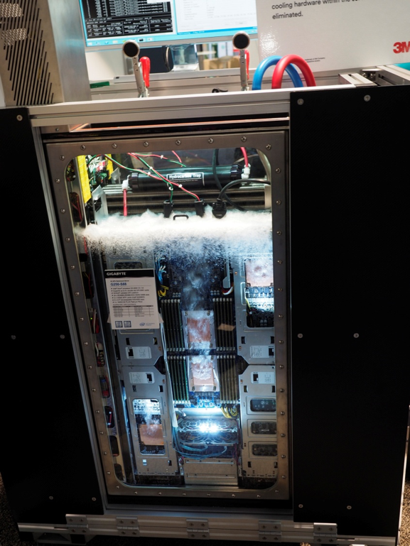 Two phase immersion cooling, consisting of a two CPU motherboard from Gigabyte with five  nVidia graphics boards (980Ti), cooled with a hydrofluoroether from 3M, Novac, that is boiling at 56o C. The top set of horizontal cylinders is a vapor recovery device.