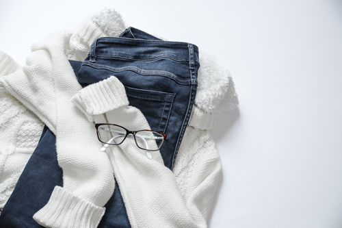 Jeans, white sweater, glasses