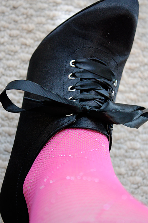pink fishnet tights closeup of ankle bootie