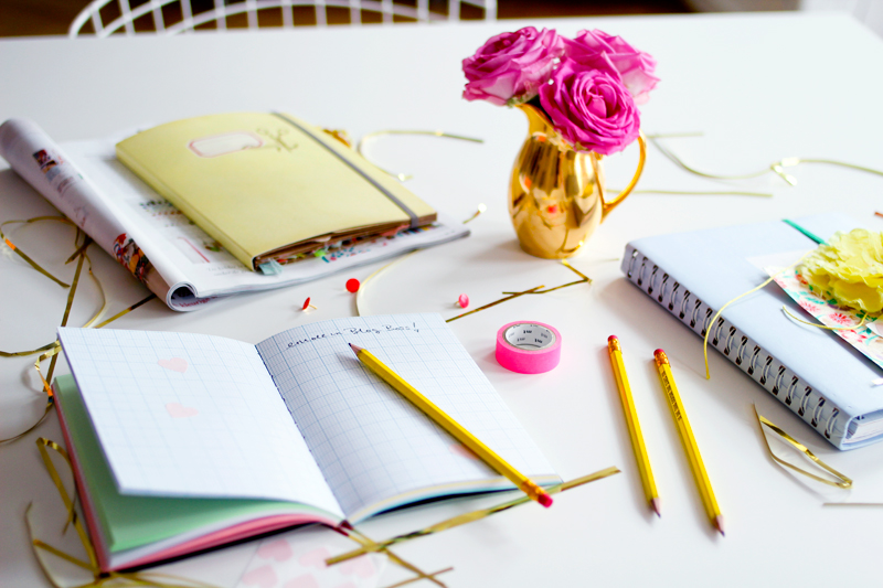 office desk gold accessories notebooks stationery planner