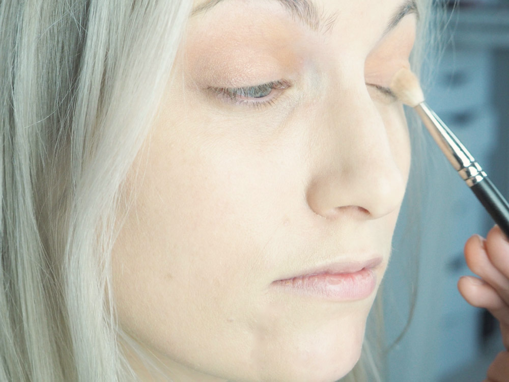 Blend that out well and add a lighter cream color onto the lid to bring your eyelids back to the forefront