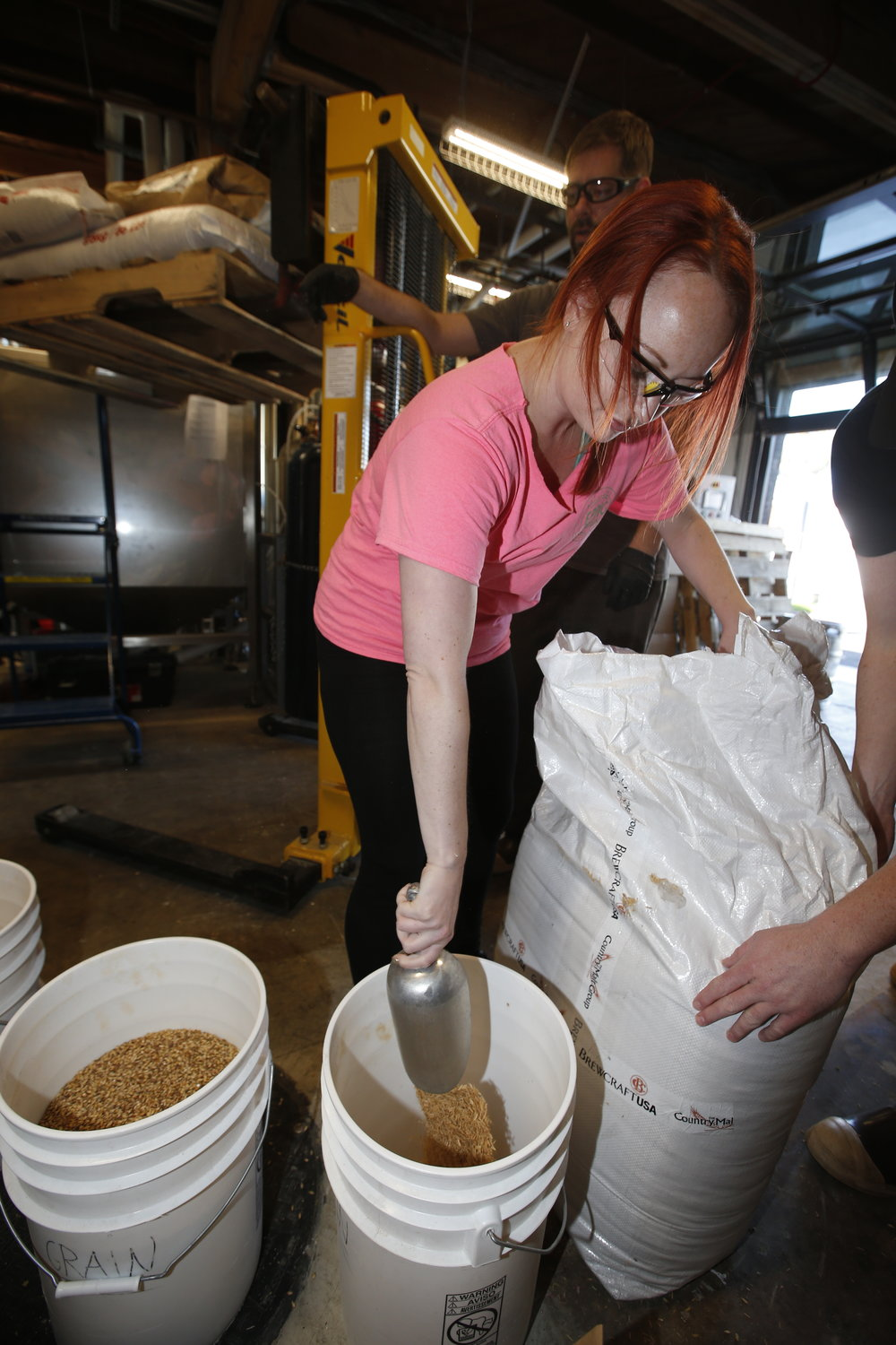 Julie measuring grain.JPG