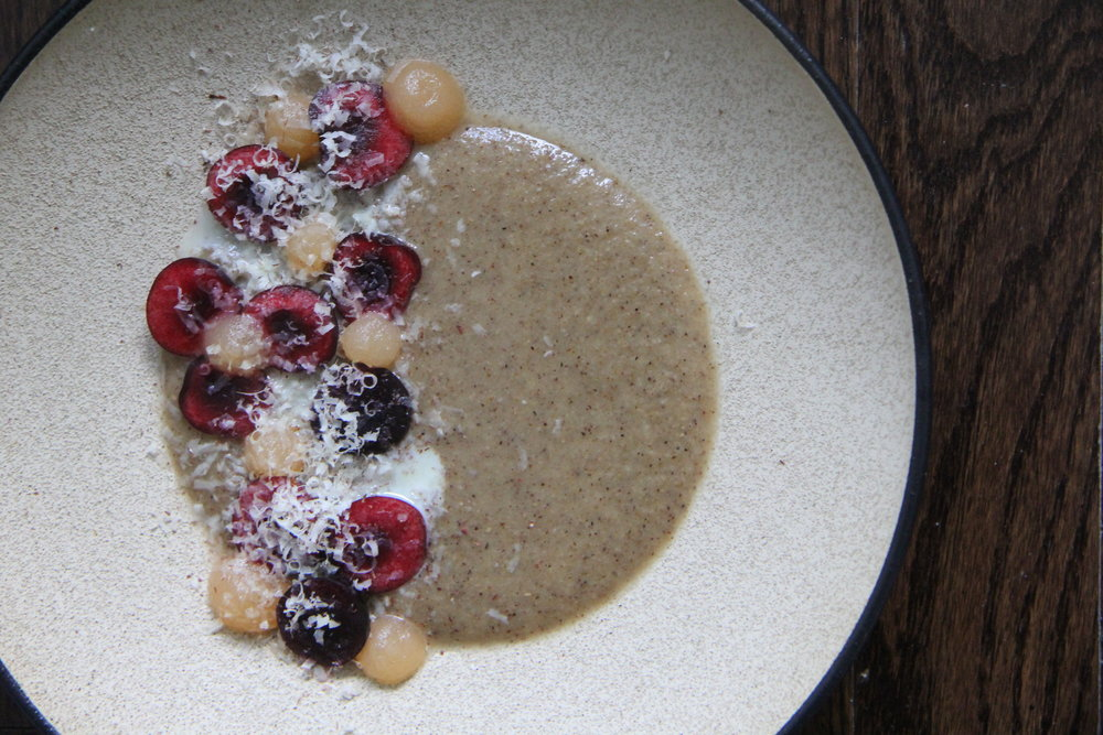 Tom Brown Porridge. Honey/grapefruit gel. Fresh cherries. Condensed milk. Shaved hazelnut.