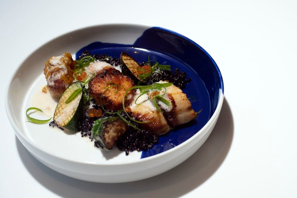Scallop Yassa. Black rice. Young squash. Palm wine butter sauce.