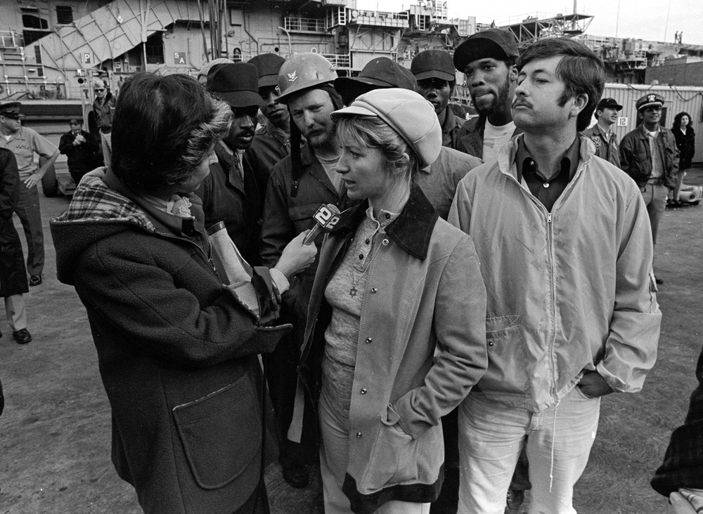 Vicki Kelly, co-leader of the Navy wives' group Save American Vessels, explains to a reporter why they want the USS Coral Sea repaired fully before it deploys in December 1974.
