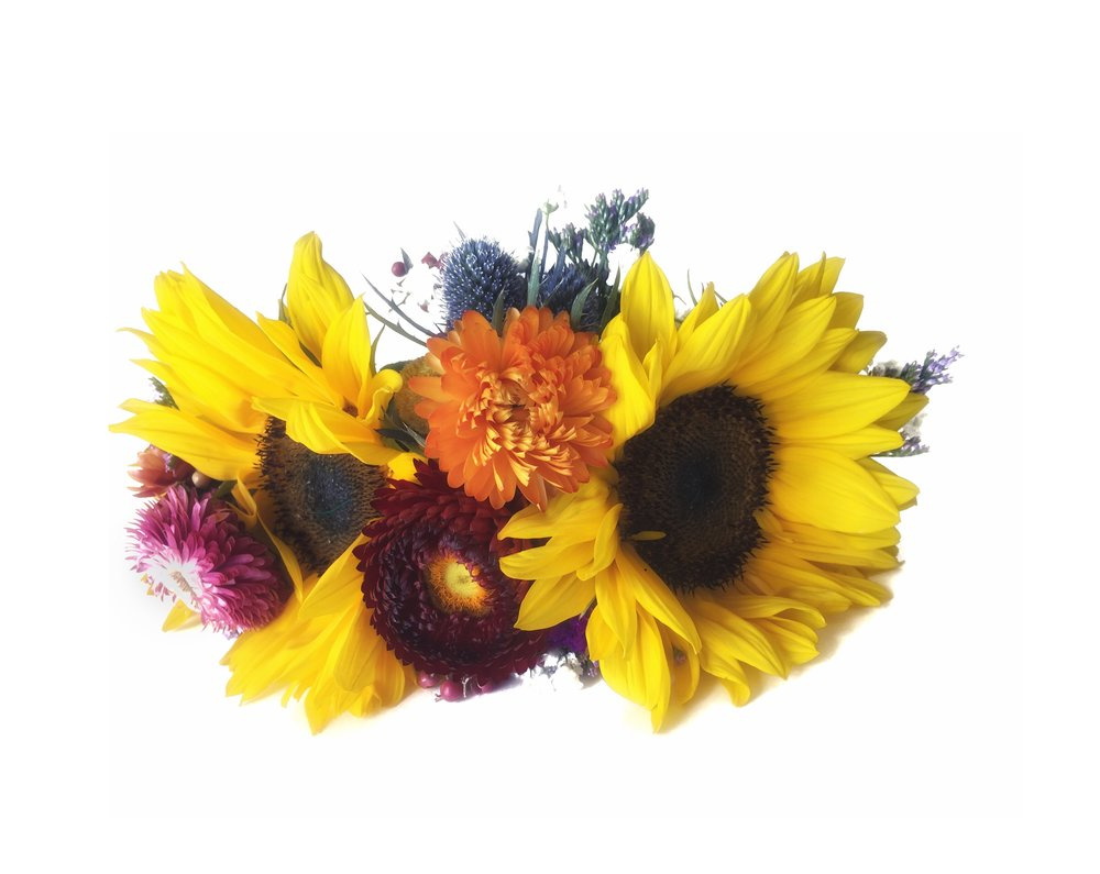 "Sunflowers are one of this years ""it"" flowers and make great, bold flower crowns because of their ability to hold up outside of water."