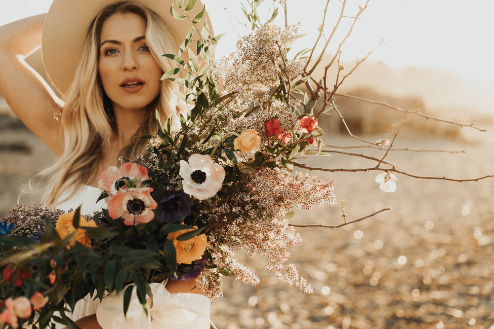 "I love getting to use my creativity to create unique, wild things.  This boho beach bridal bouquet uses the language of flowers to express ""Freedom, beauty, truth and love""."