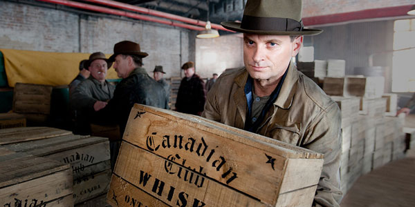 Eli Thompson helps carry a box of Canadian Club Whisky. Eli is the former Atlantic County Sheriff and the younger brother of Atlantic City crime boss Nucky Thompson.