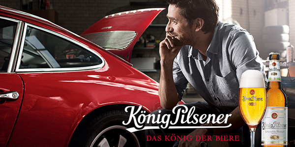 "In an advertisement for Koenig Pilsener, this man ponders ""das koenig der biere"", which loosely translates to ""how many Koenig bottle caps can I fit in the trunk of this Porsche?"""