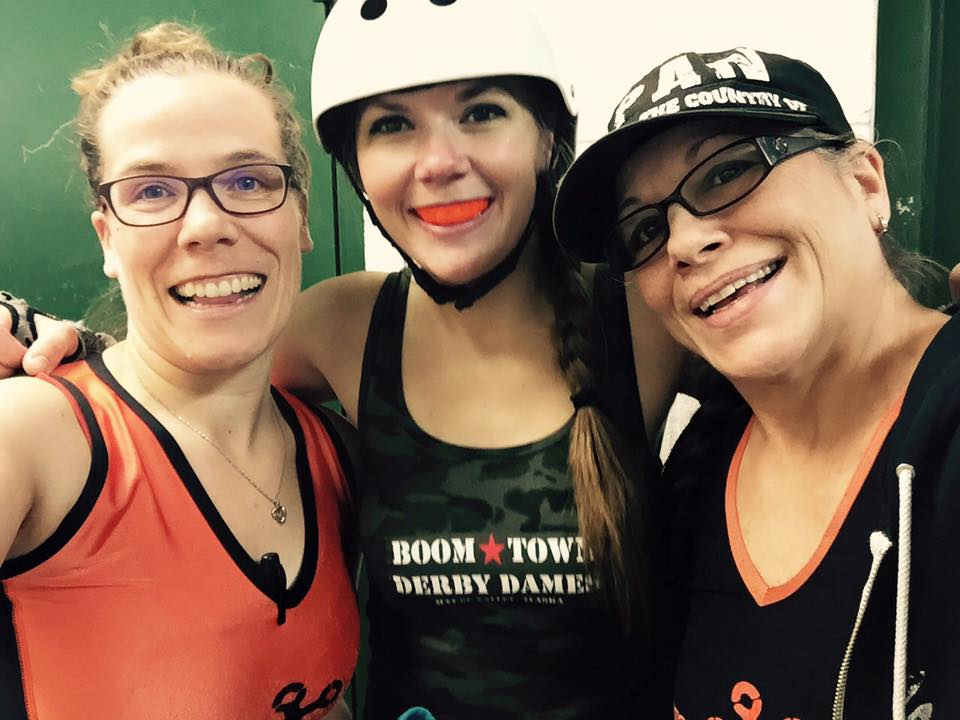 Sally (center) with Spenard Itch (left) and Pat Riot of Rage City Rollergirls
