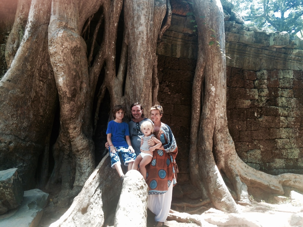 this is us on a big tree at another temple. The trees roots grow through the temple. This is where the film Tomb Raider was set.