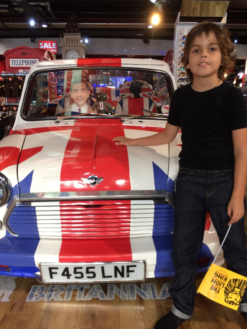 this was in a shop and mr bean was in the car. It was really cool because it had the british flag on it. In this shop there was heaps of english flags.