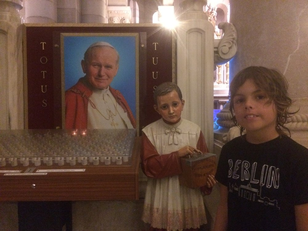 this is where they get the candle and where they put the money box but it was the wrong day to put the wishing candles down. This is a picture of the old pope - pope john.