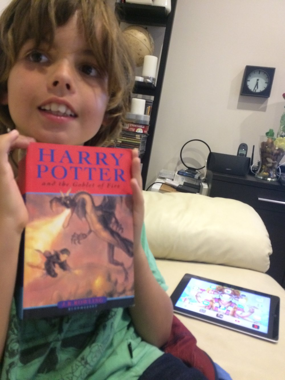 this is the book called HARRY POTTER AND THE GOBLETS OF FIRE and its really hard to read it. I reckon the cover looks epic with a dragon and Harry Potter.