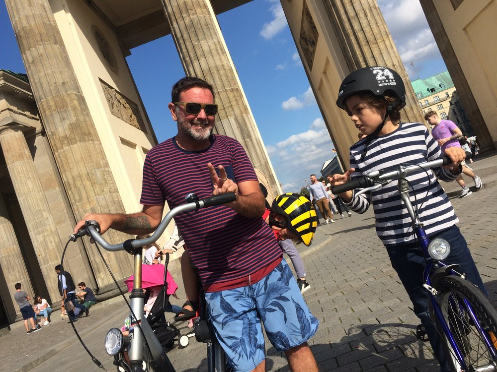 We rode our bikes Brandenburg gates  The gate is one of Berlin's best-known places in berlin and a symbol that is important history events of the 19th and 20th centuries. Today, the gate is viewed above all as a symbol for unification - when East and West Berlin came back together as it was split for many years. We also ride our bikes down streets and other places like that.it is our favourit thing to do.