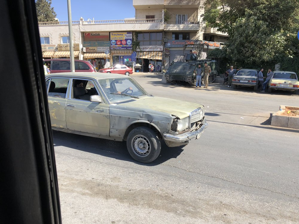 there were a lot of a old cars in Lebanon some of them look beautiful but some were wrecked but th weird thing is that they still used the cars even if they were destroyed. And if you haven't noticed yet there is a tank in the back ground that has soldiers all around the tank.... Which is crazy right.