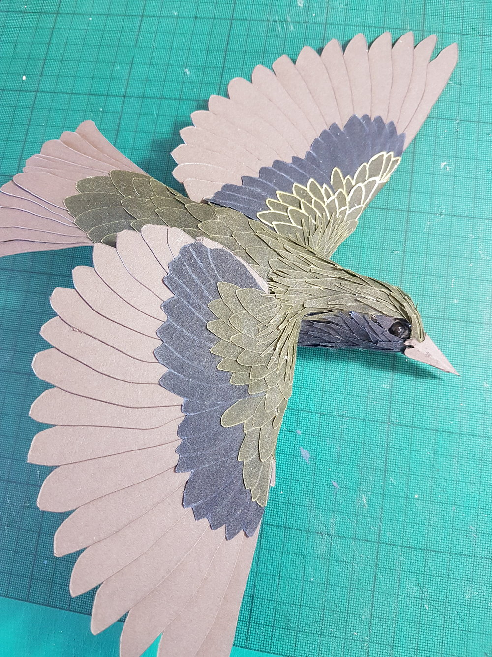 Lastly Gold paint was applied to the ends and edges of the feathers to make them look more like starlings as well as stand out when all flocking together.
