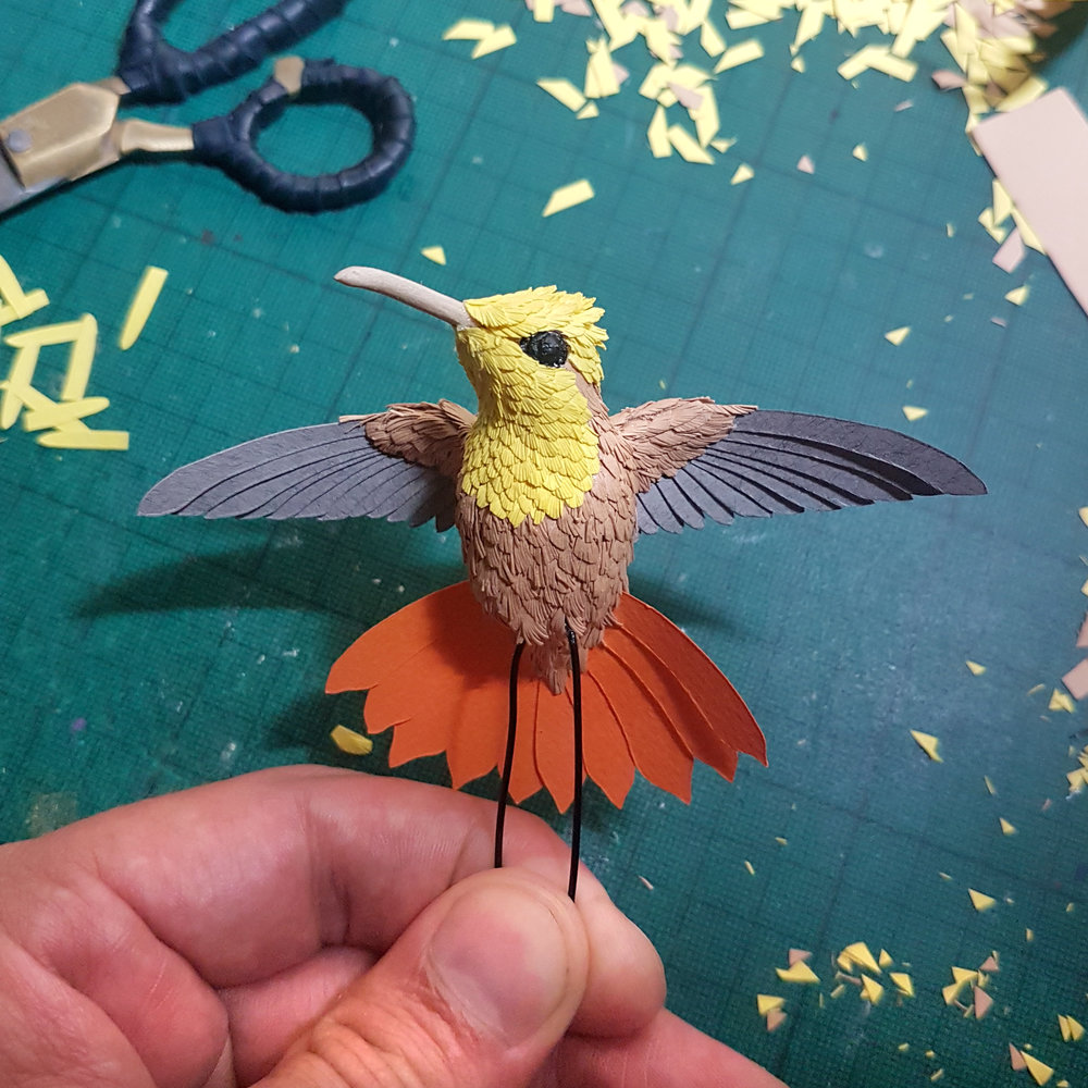 Tiny Ruby Topaz hummingbird sculpture.
