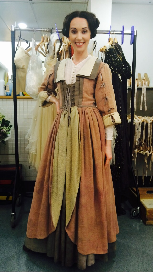 Kristen as 'Bertha'.    Love the cross stitching on the sleeves.