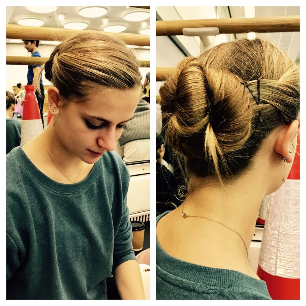 Julia with a twirl in a low bun