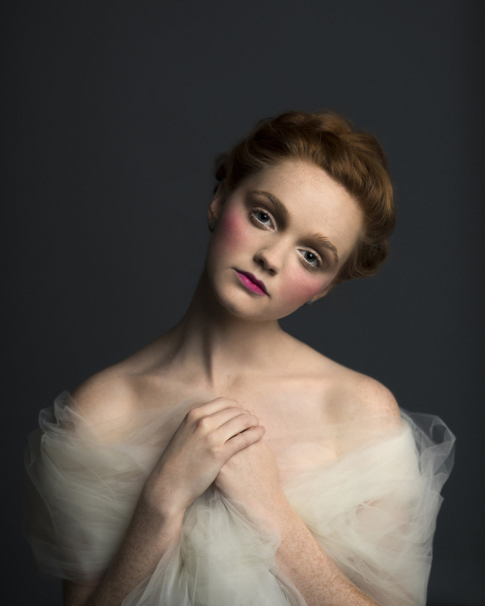 Romantic Victorian inspired studio portrait of a redhead model in tulle. By Sarah Hooker Photography