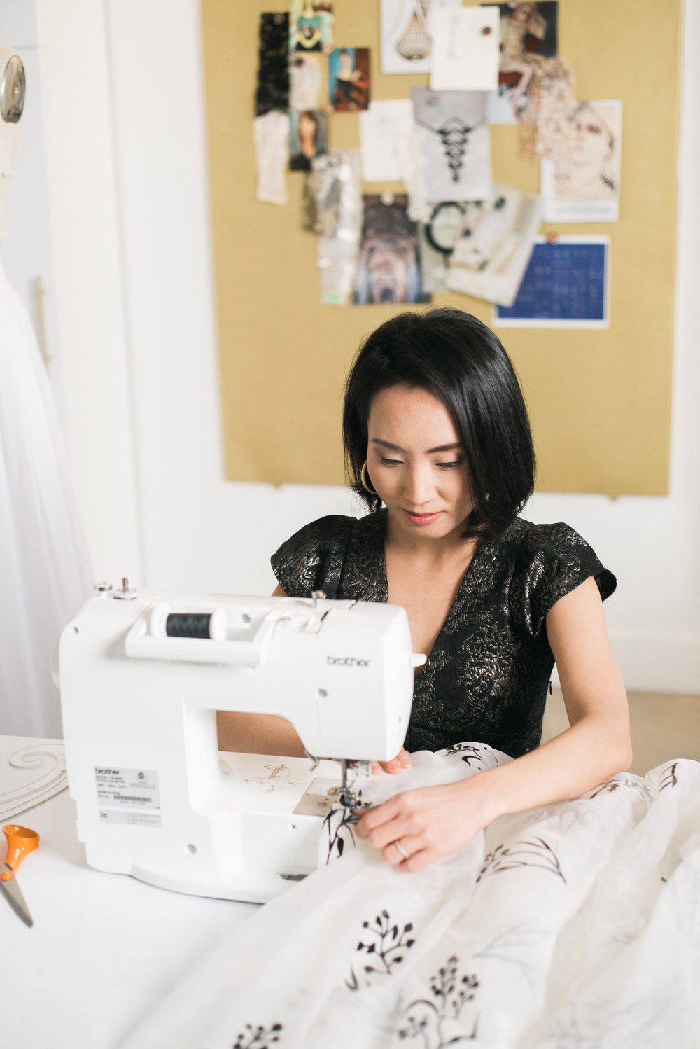 Angela Kim of Asheville Couture at sewing machine | Photography by Sarah Hooker Photography