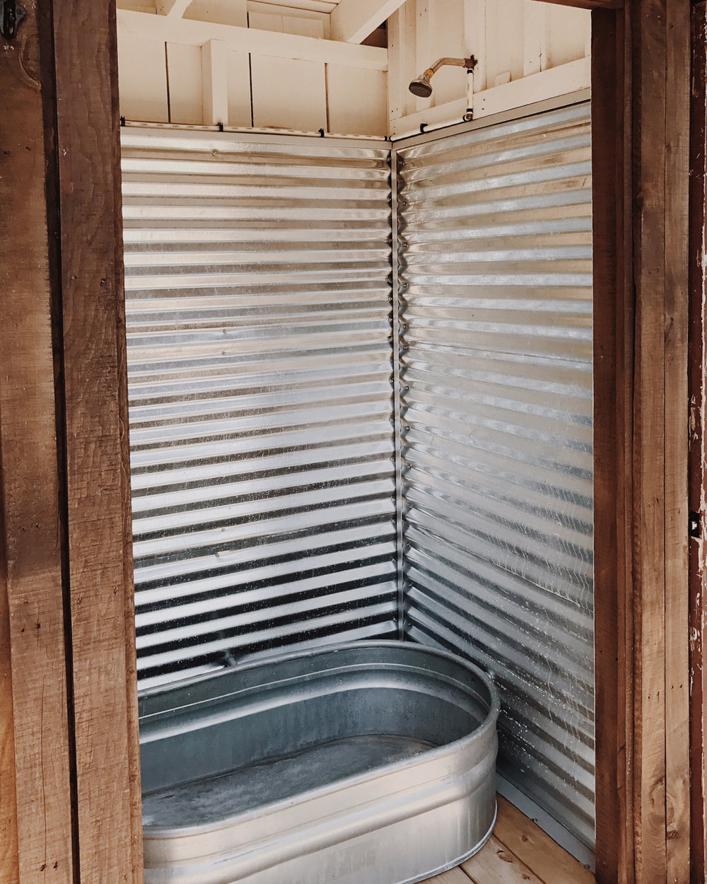 Simple iPhone photo of the cabin's shower/tub from when I visited to preview it.