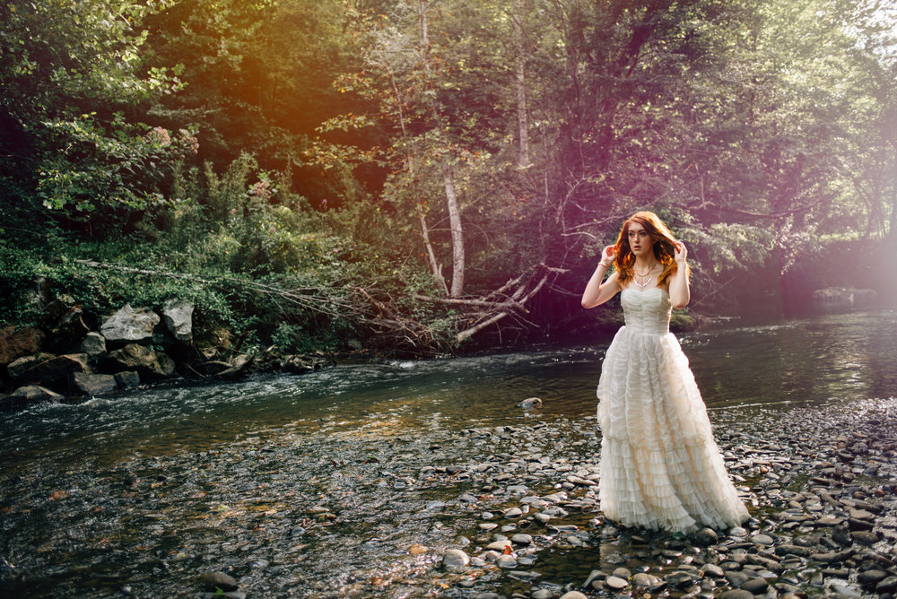 White vintage dress in the water with flowers by Sarah Hooker Photography