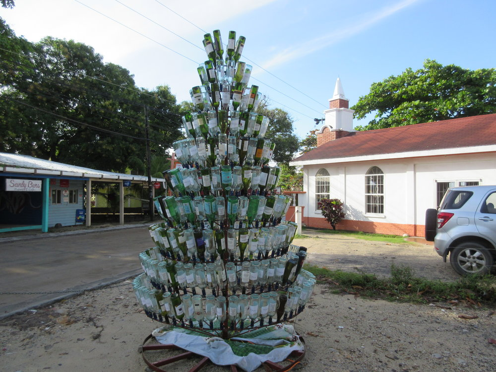 Nothing says the holidays like a wine bottle Christmas tree in the church parking lot.