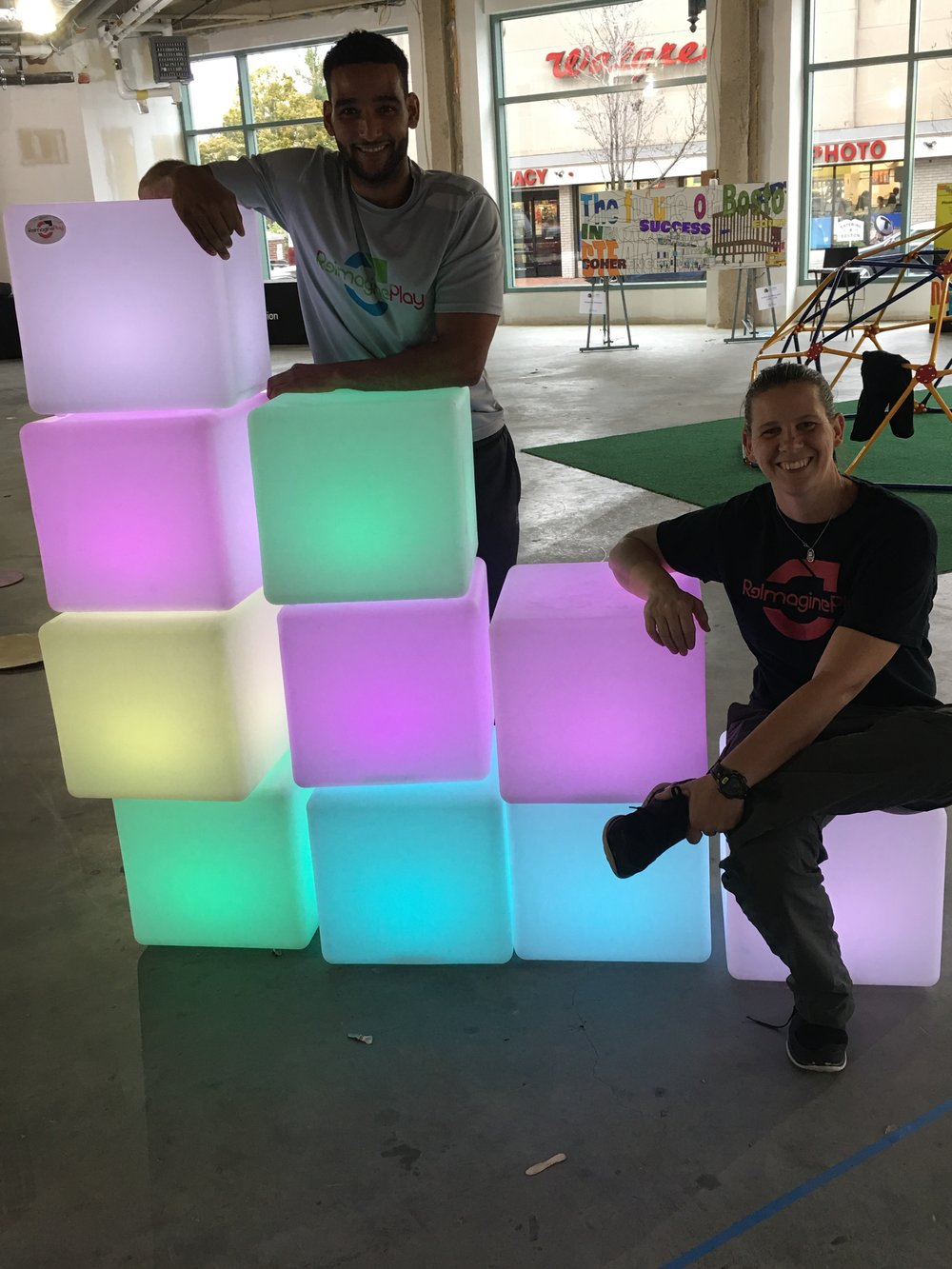 Light boxes offered a place to sit for caregivers and an interactive play activity for kids.