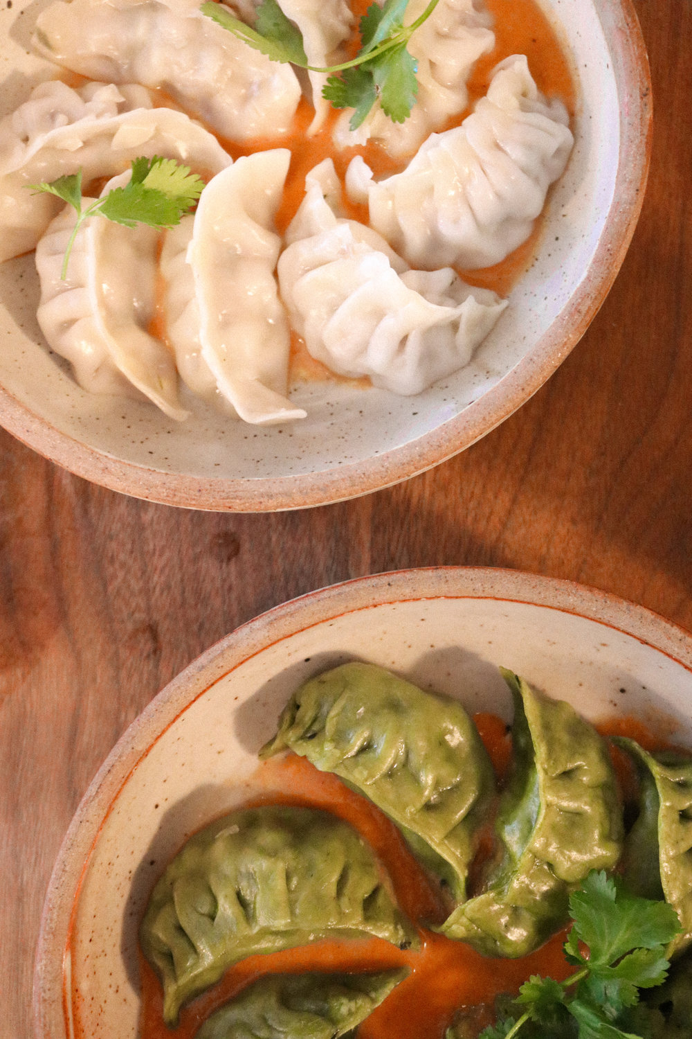 Chicken momo (top left) and vegetable momo (bottom right)