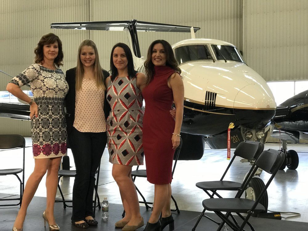 Members of Elevate Aviation - Left to Right: Nicola Crosbie, Board of Directors; Sophia Wells, Director of Advocacy; Laura Foote, Director of Operations; and Kendra Kincade, Founder and Chair.