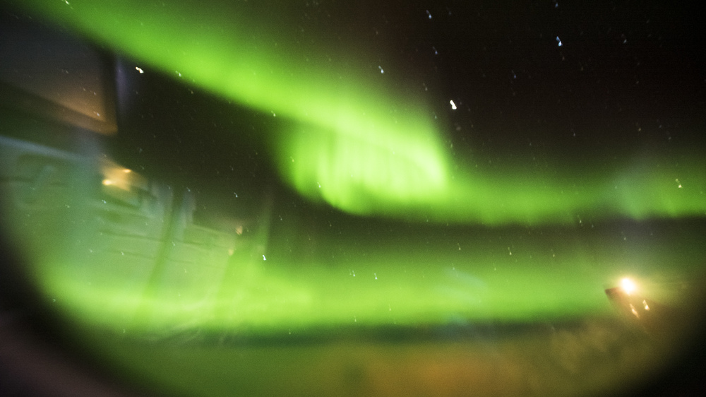 The Aurora on the way home from the plane window.
