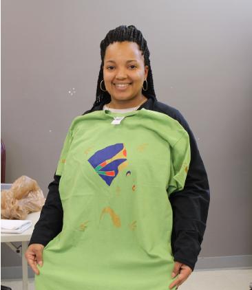 Boys & Girls Club Program Director, Ms. Tasha Burgo, with her Nefertiti Spirit shirt.
