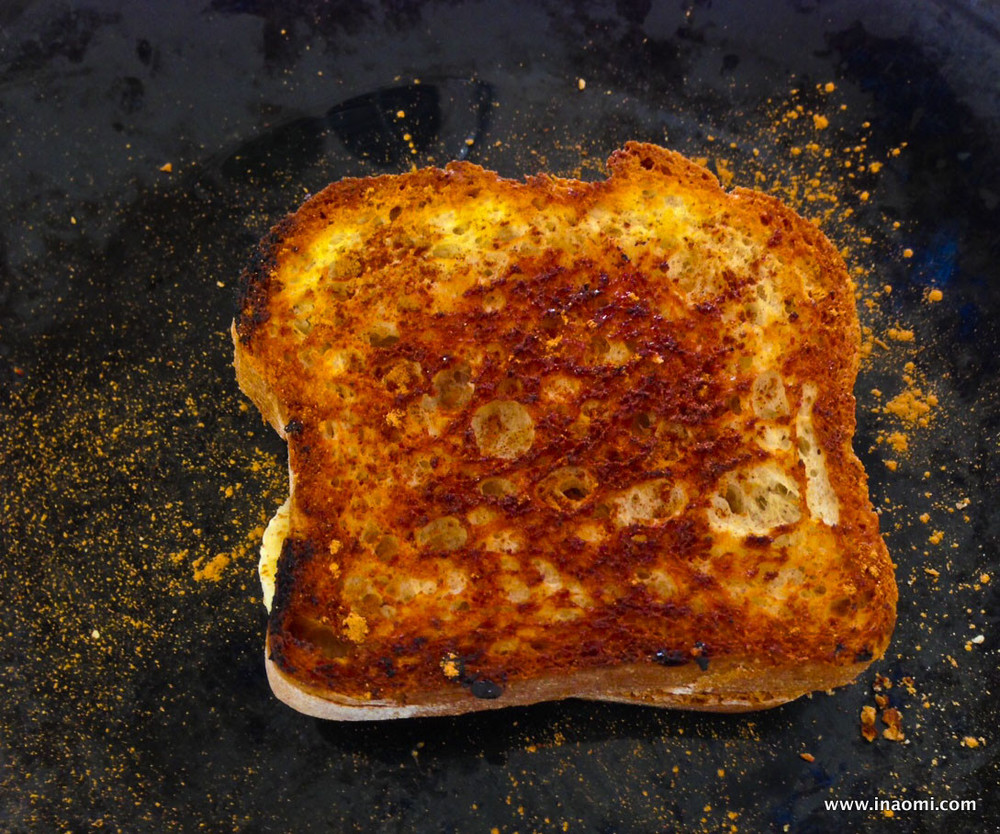 Spiced Peanut Butter Banana Honey Grilled Sandwiches sprinkled with cinnamon
